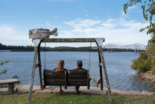 Before going back to their home in Evansville at the end of the weekend, Valerie and Dan Hufford take in the view and fresh air at their camp at the riverbank in Dade, Ky., on Oct. 22, 2017.