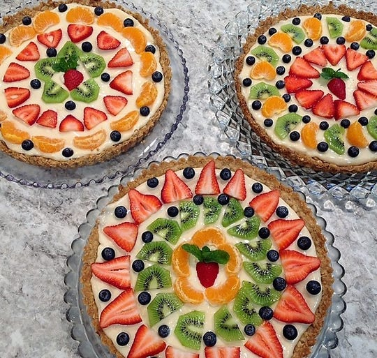 Colorful and fresh pastry cream tarts with fresh fruit from Denise Rapp's Moveable Feast.