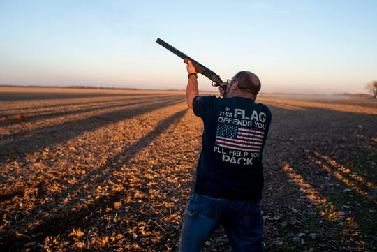 Joe Koontz shoots at a clay target in an empty field behind the riverbank in Dade, Ky., on Nov. 28, 2017.