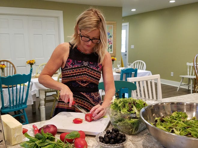 Denise Rapp prepares Italian salad in her New Harmony Kitchen on Sept. 21, 2018.