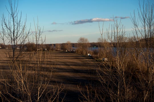 The row of camps line the riverbank between the fields and the Ohio River on Dec. 6, 2017.