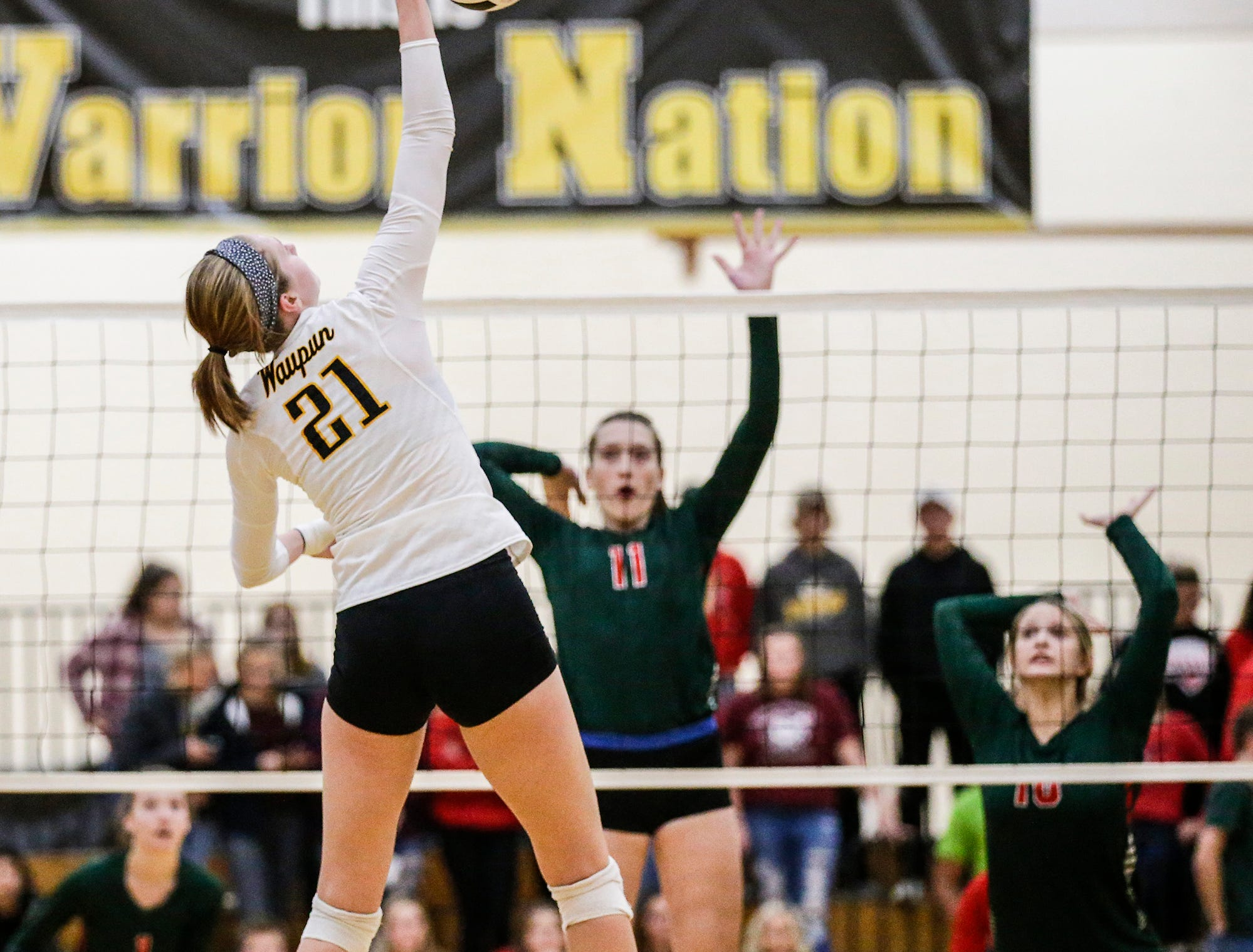 Waupun High School volleyball's Claire Bresser hits the ball against Berlin High School during their WIAA regional quarter-final playoff game Tuesday, Oct. 16, 2018 in Waupun.