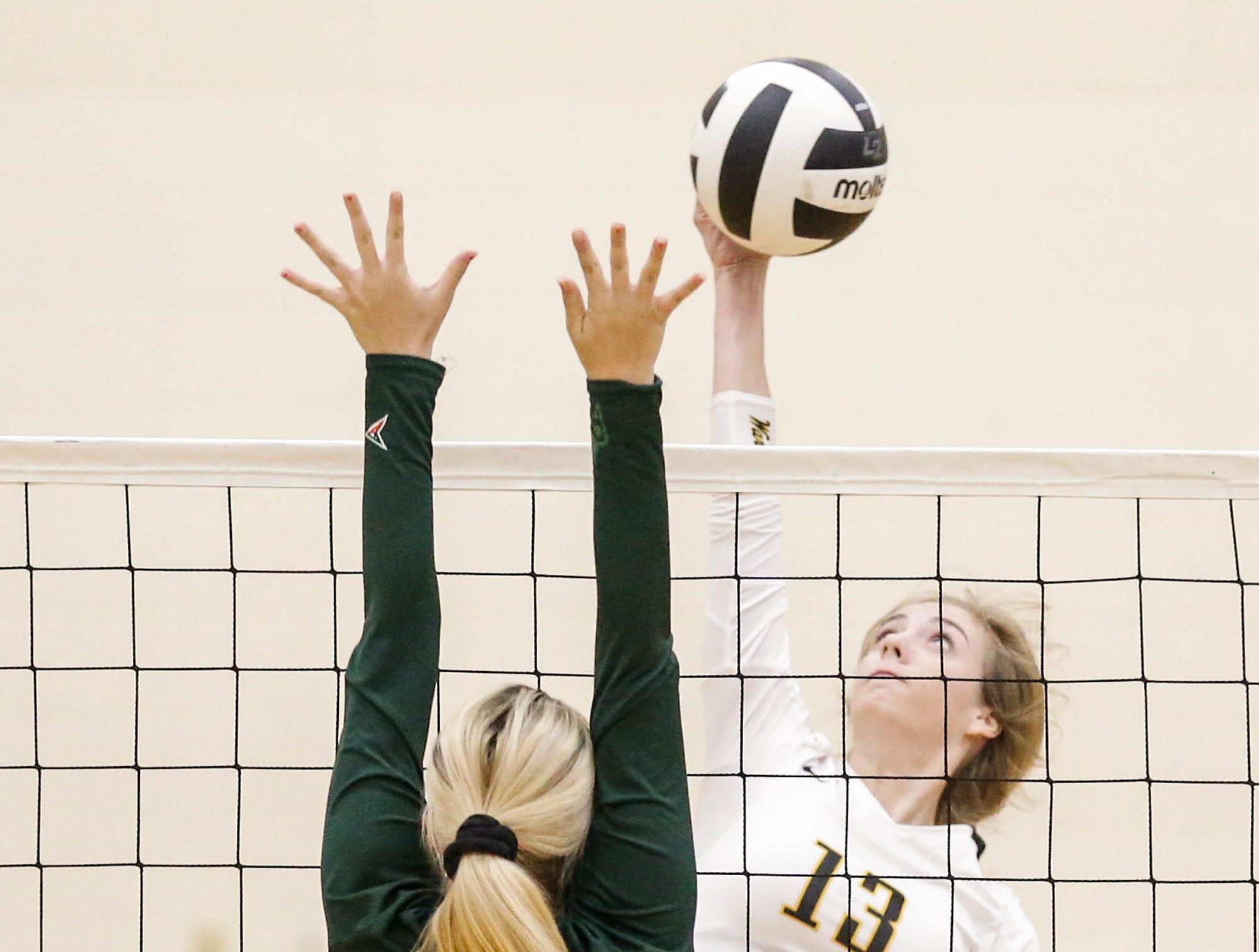 Waupun High School volleyball's McKenna Cunningham hits the ball against Berlin High School during their WIAA regional quarter-final playoff game Tuesday, Oct. 16, 2018, in Waupun.
