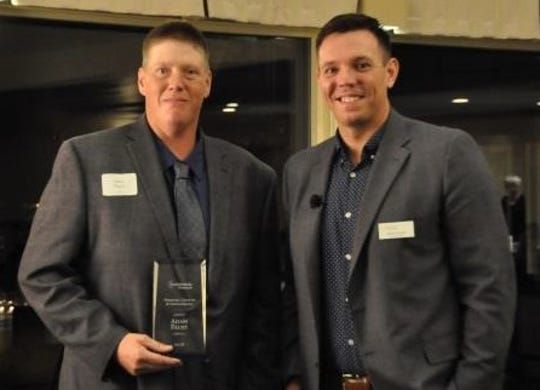 Adam Faust accepts the award for Personal Growth & Development from Easter Seals Wisconsin Board Member Andy Crooks.