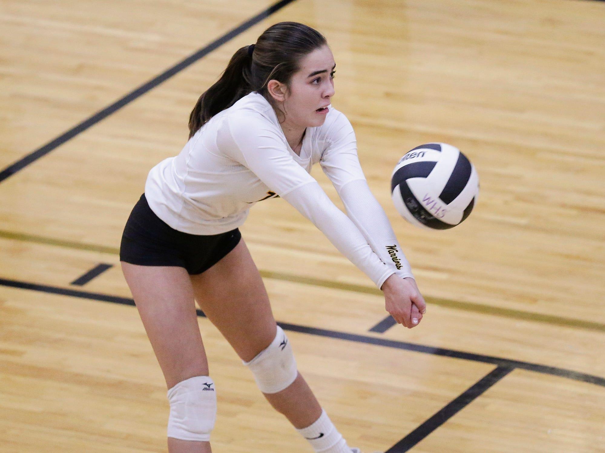 Waupun High School volleyball's Hannah Scholten hits the ball against Berlin High School during their WIAA regional quarter-final playoff game Tuesday, Oct. 16, 2018, in Waupun.
