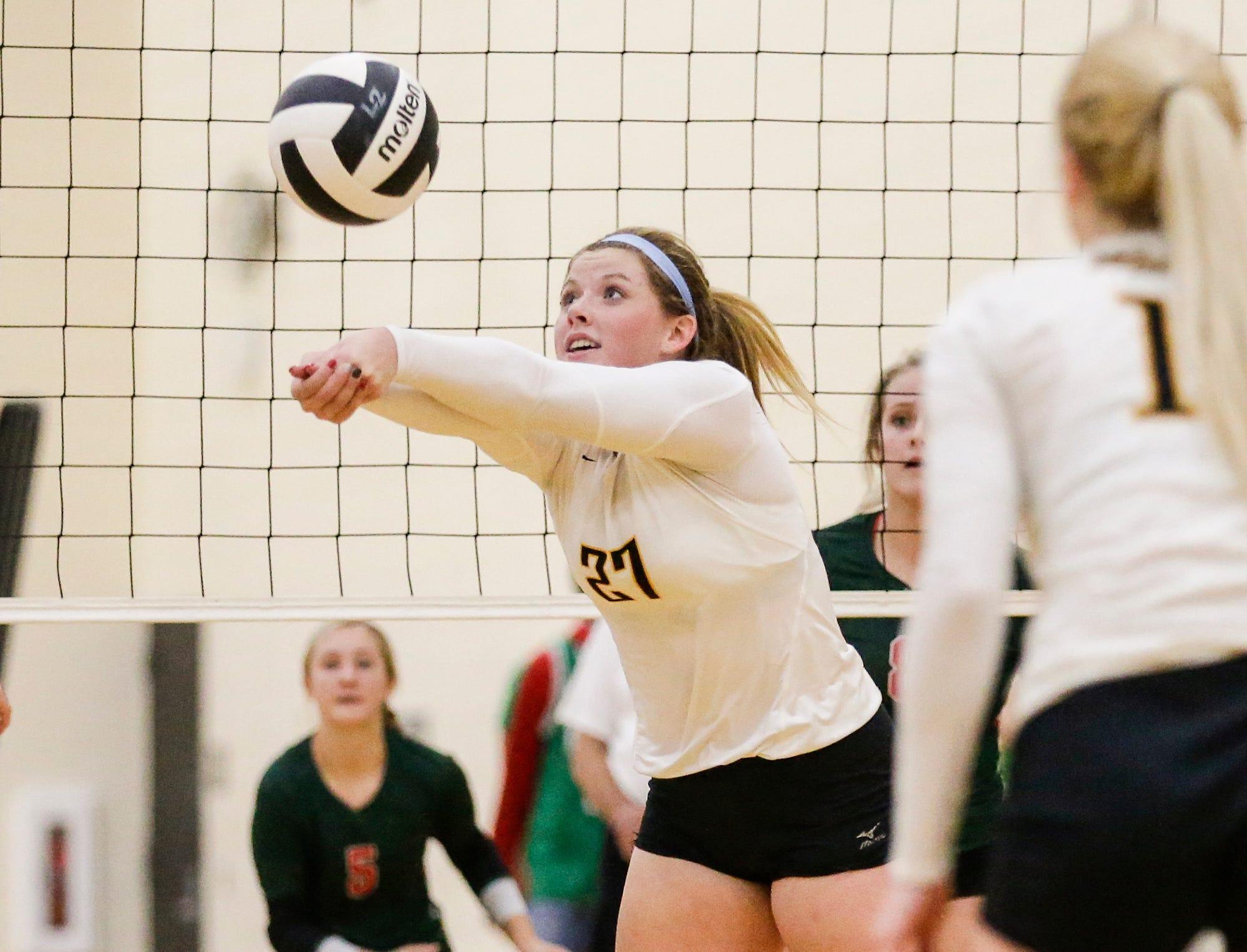 Waupun High School volleyball's Haley Huenink hits the ball against Berlin High School during their WIAA regional quarter-final playoff game Tuesday, Oct. 16, 2018, in Waupun.