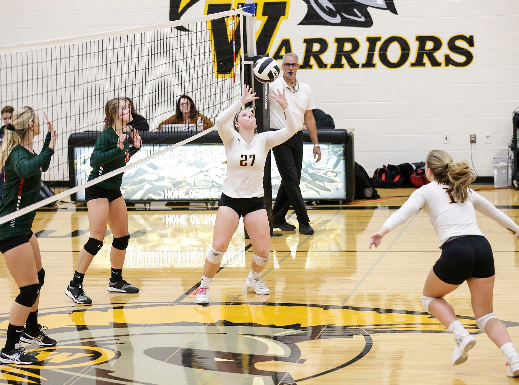 Waupun High School volleyball's Haley Huenink sets the ball for Emily Rens during their WIAA regional quarter-final playoff game against Berlin High School Tuesday, Oct. 16, 2018, in Waupun.