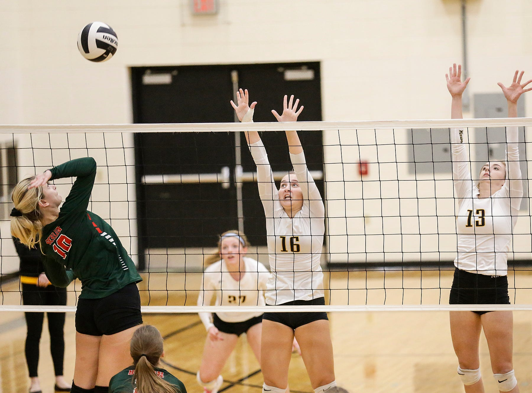 Waupun High School volleyball's Ruby Flegner and McKenna Cunningham go up to block a shot from Berlin High School's Alysha Pischke during their WIAA regional quarter-final playoff game Tuesday, Oct. 16, 2018, in Waupun.