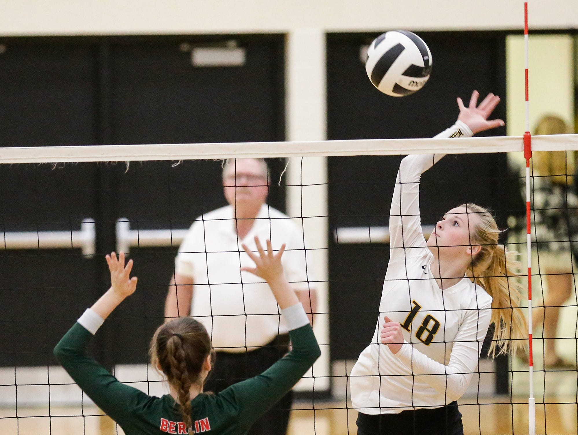 Waupun High School volleyball's Makenna Harmsen hits the ball against Berlin High School during their WIAA regional quarter-final playoff game Tuesday, Oct. 16, 2018, in Waupun.