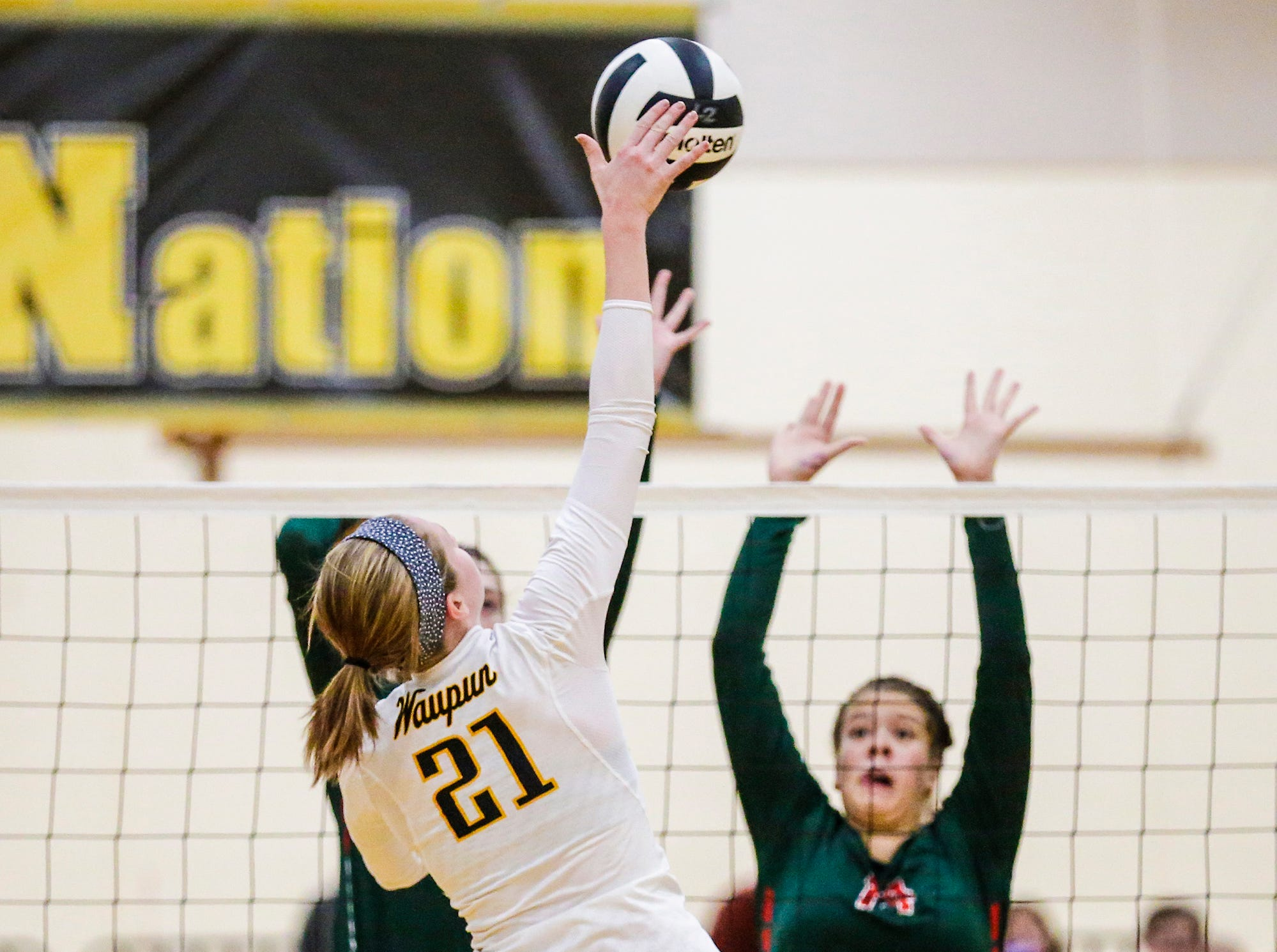 Waupun High School volleyball's Claire Bresser hits the ball against Berlin High School during their WIAA regional quarter-final playoff game Tuesday, Oct. 16, 2018, in Waupun.