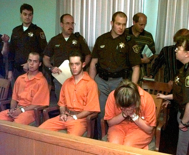 In this Oct. 9, 1998 file photo, from left are Russell Henderson, Aaron McKinney, and Chasity Pasley, three suspects in the beating death of gay University of Wyoming student Matthew Shepard wait to be arraigned in Laramie, Wyo.  The murder of Shepard was a watershed moment for gay rights and LGBTQ acceptance in the U.S., so much so that 20 years later the crime remains seared into the national consciousness.