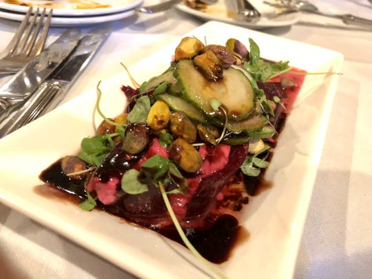 Harold's serves a terrine of beets and local feta with pickled cucumbers and pistachios for $10.