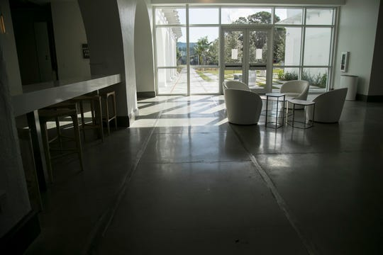 The Collaboratory in downtown Fort Myers includes a train track running through the building and out to the street as a nod to the building's former use as a train depot.