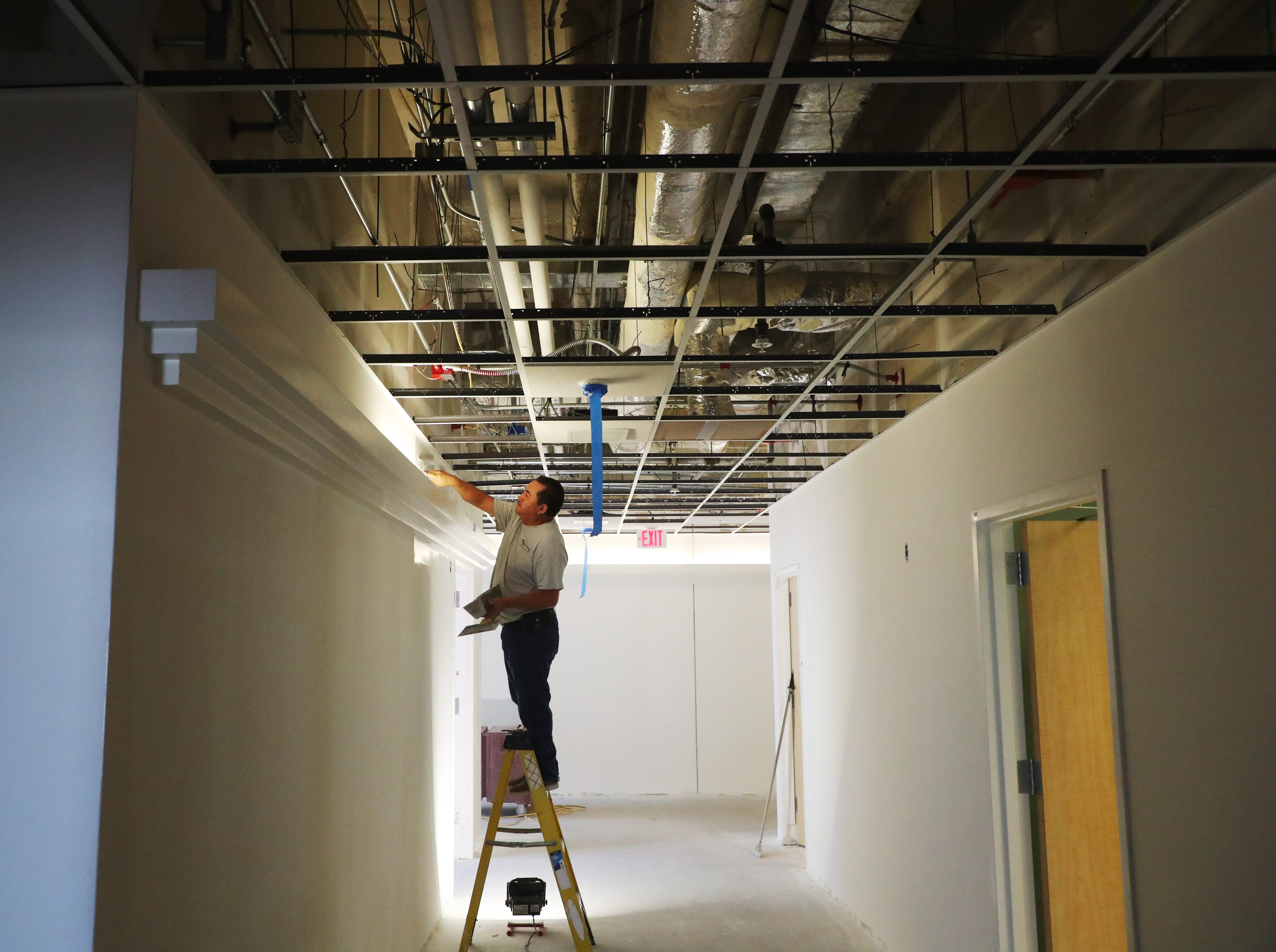Cecilio Martinez, of Sega Drywall, a sub-contractor for R.D. Johnson Construction works in an area that is being renovated for the expansion of the of obstetrical services and new and renovated OB rooms at HealthPark Medical Center. The health system will now feature 107 OB beds, and all of the newly renovated rooms at HPMC will be fully private with family sleep capabilities. This transition will create 10 additional beds across the health system and as of March 1, 2019, the obstetrical service line currently offered at Gulf Coast Medical Center will be transferred to HealthPark.
