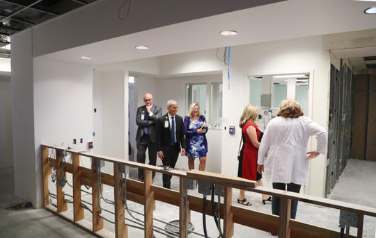 From left, top Lee Heath officials Dr. Eric Applegren, Scott Kashman, Susan Ryckman, Therese Everly and Susan DiMatteo take a tour of the renovated OB rooms at HealthPark Medical Center. The health system will feature 107 OB beds, and all of the newly renovated rooms at HPMC will be fully private with family sleep capabilities.