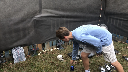 Easley High School student Luke Willis gives a sneak preview of his haunted attraction, Asylum.