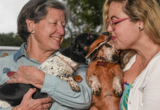 Ali Strother, right, plays with her 12-year old dog Pinnochio, while her mother, Jean Strother, holds 2-year old Chrysanthemum, at their home in Greenville. Ali said Jean has always loved dogs and music.