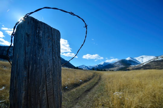 A barbed wire fence post marks the McFarland White Ranch property line. The Forest Service and the ranch have have been unable to agree on a reciprocal access agreement.