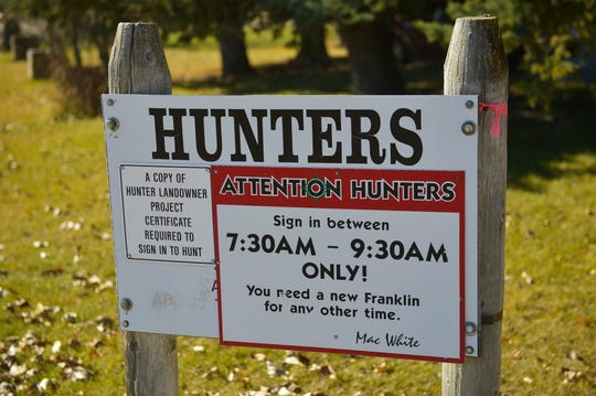 A sign notifying hunters when to sign in to access hunting at the McFarland White Ranch in Two Dot, Mont.