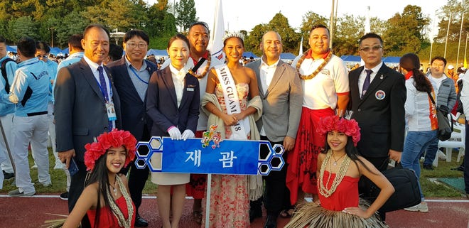 Team Guam at the 99th Korea Sports Festival. Pictured from left: President of Korean Association of Guam Jay Park, Heesoo Lee, Guma Taotao Tano' musician Vince San Nicolas, Miss International Guam 2018 Diliana Tuncap, GVB destination specialist - sports and events Kraig Camacho, Guma Taotao Tano' musician Richard Quitugua, and President of Korean Sports Council of Guam Woon Sang Yoo. Bottom row: Megan Halmi and Vivian Amon.