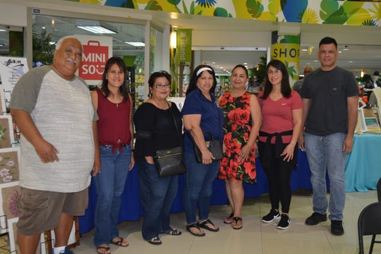 CAHA Staff and management from left:  Paul Cruz, Sherrie Barcinas, Jackie Balbas, Angie Taitague, deputy director Joyce Bamba, Brea Bailey and Mark Duenas during CAHA's Arts and Humanities Month at Agana Shopping Center on October 7.