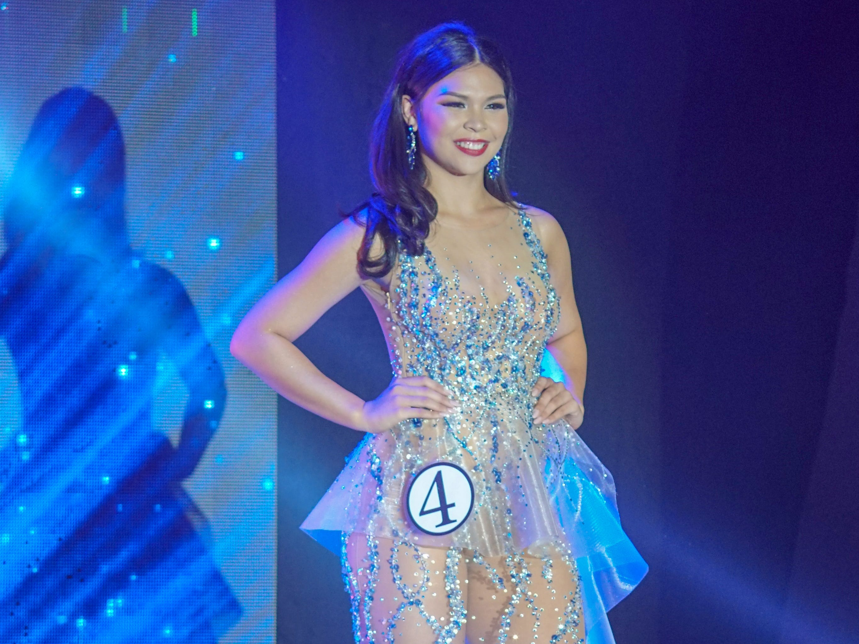 Contestant #4 Mariana Quintanilla Kier, 18, from Sinajana, is all smiles in her evening gown during the Miss World Guam pageant held at Sheraton Laguna Guam Resort.