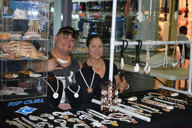 Local Artists Frank Mantanane and Christine Rosa of Kiko's Local Art during CAHA's Arts and Humanities Month at Guam Premier Outlets on October 6.