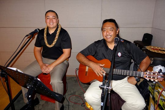 Guma Taotao Tano' musicians Richard Quitugua and Vince San Nicolas take a photo during the Korea Roadshow in Gwangju.