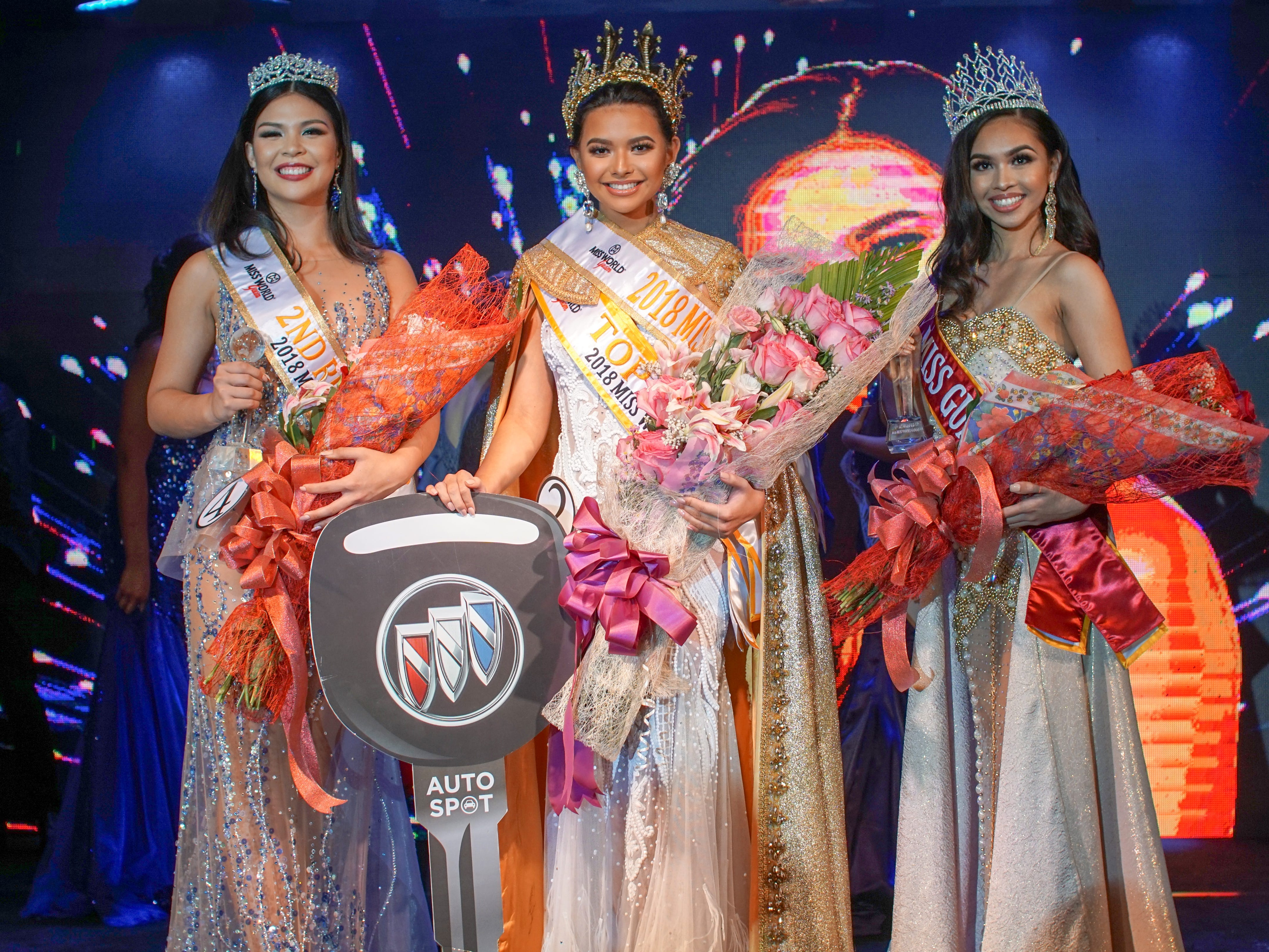 Left is 2nd Runner up Contestant #4 Mariana Quintanilla Kier, 18, of Sinajana and to the far right is, Contestant #5 Cyndal Abad, 18, of Dededo. She wins Ms. Asia Pacific International. Center is, Contestant #2 Gianna Camacho Sgambelluri, 18, of Barrigada, whom is crowned 2018 Miss World Guam. The event was held at Sheraton Laguna Guam Resort.