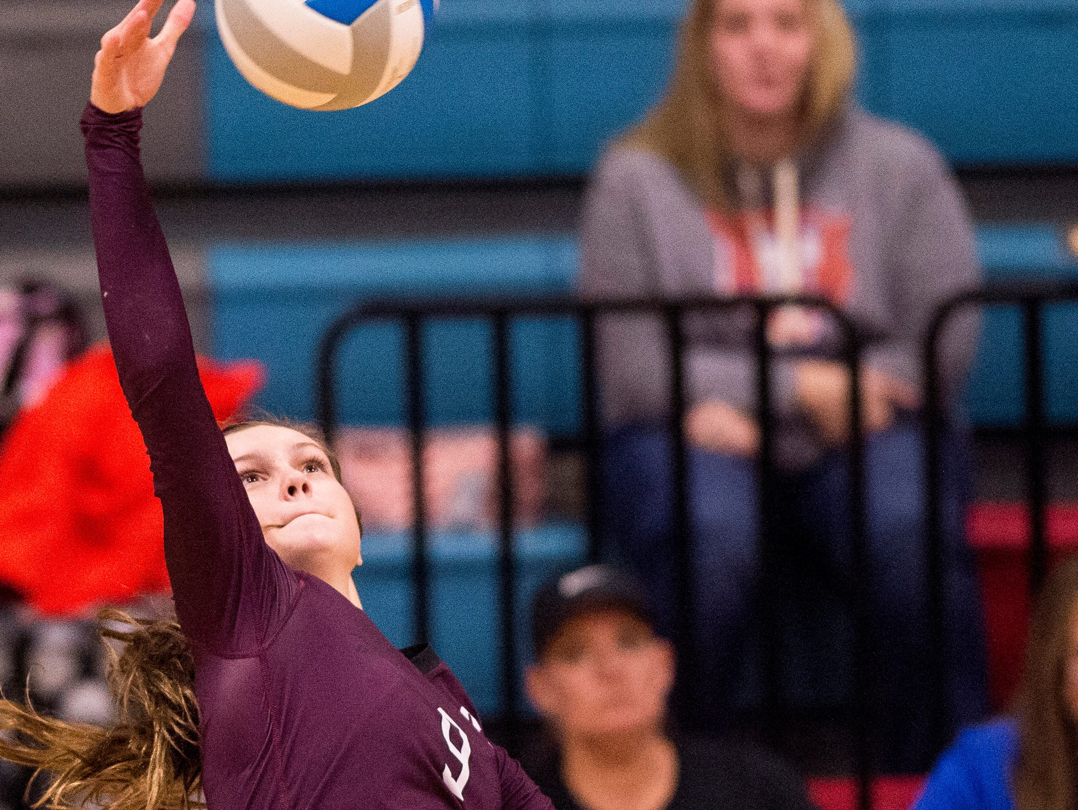 Henderson's Jordan Troutman (9) attacks in the Second Region Tournament game against the Hopkinsville Lady Tigers in Morganfield Tuesday, Oct. 16, 2018. Henderson beat Hopkinsville, 3-1.