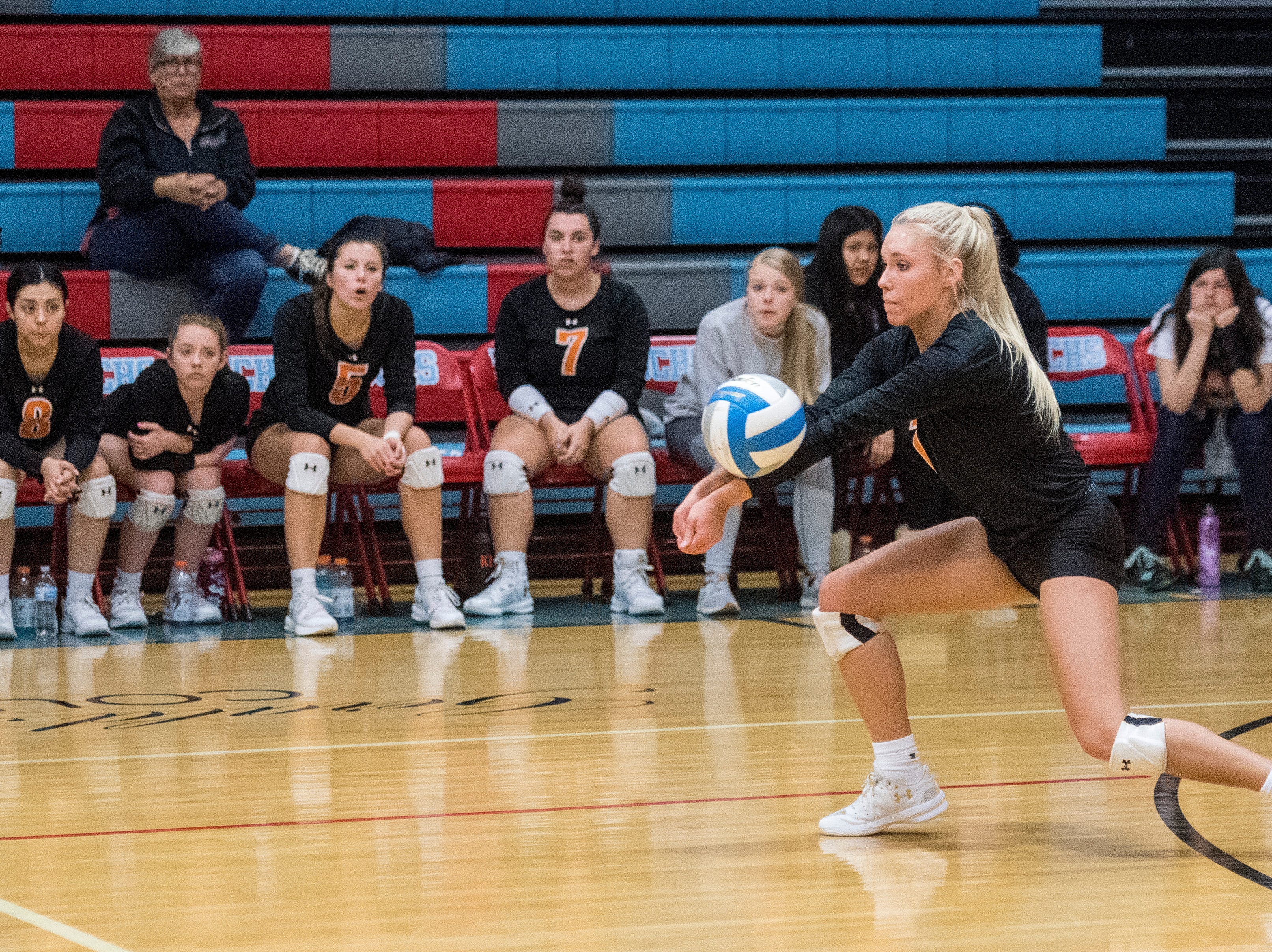 Hopkinsville's Sarah Cavanah (1) sets the ball during the Second Region Tournament game against the Henderson County Lady Colonels in Morganfield Tuesday, Oct. 16, 2018. Henderson beat Hopkinsville, 3-1.
