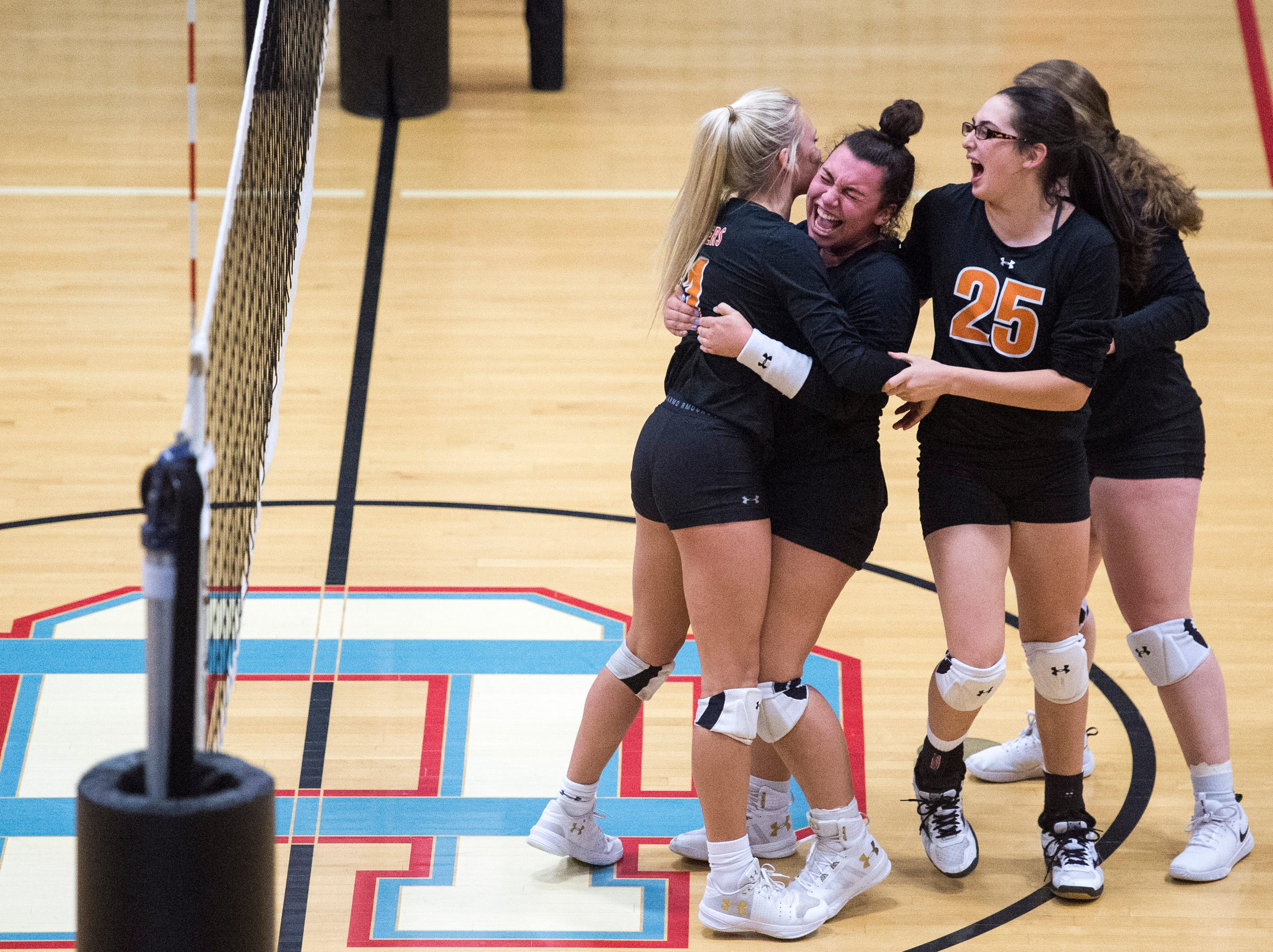 Hopkinsville Lady Tigers celebrate while playing Henderson County in the Second Region Tournament in Morganfield Tuesday, Oct. 16, 2018. Henderson beat Hopkinsville, 3-1.