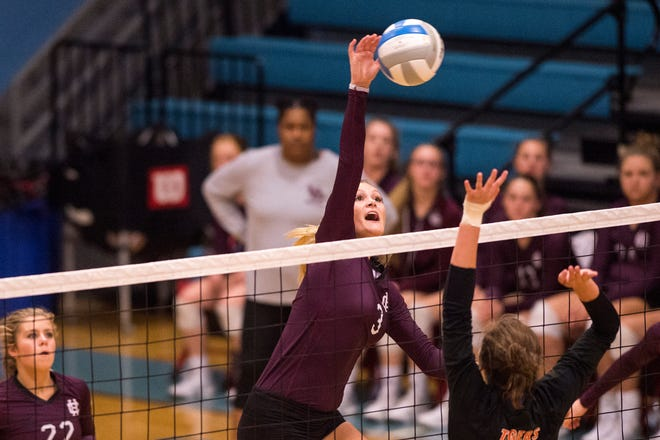 Henderson's Hannah Watkins (3) attacks in the Second Region Tournament game against the Hopkinsville Lady Tigers in Morganfield Tuesday, Oct. 16, 2018. Henderson County beat Hopkinsville, 3-1.
