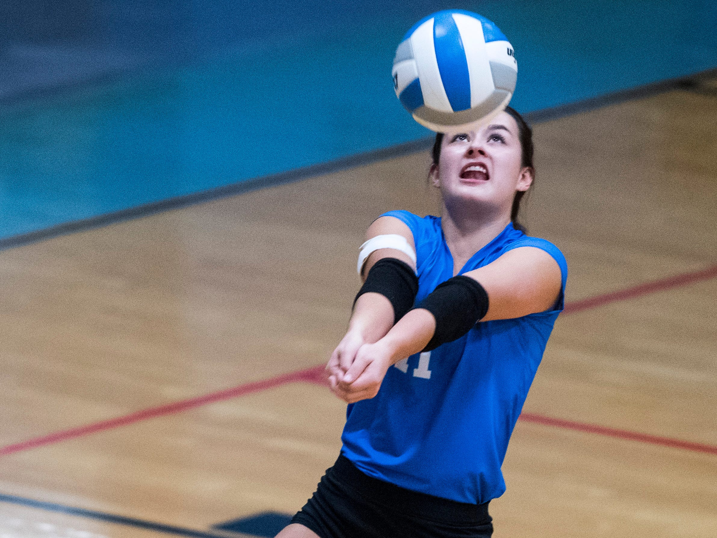 Henderson's Maggie Vincent (11) sets the ball during the Second Region Tournament game against the Hopkinsville Lady Tigers in Morganfield Tuesday, Oct. 16, 2018. Henderson County beat Hopkinsville, 3-1.