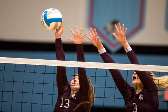 Henderson's Athena Sumner (13) blocks the ball during the Second Region Tournament game against the Hopkinsville Lady Tigers in Morganfield Tuesday, Oct. 16, 2018. Henderson County beat Hopkinsville, 3-1.
