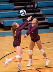 Henderson's Janae Bailey (4) sets the ball for a teammate in the Second Region Tournament game against the Hopkinsville Lady Tigers in Morganfield Tuesday, Oct. 16, 2018.