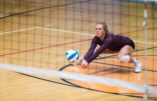 Henderson's Avery Marshall (22) sets the ball during the Second Region Tournament game against the Hopkinsville Lady Tigers in Morganfield Tuesday, Oct. 16, 2018. Henderson County beat Hopkinsville, 3-1.