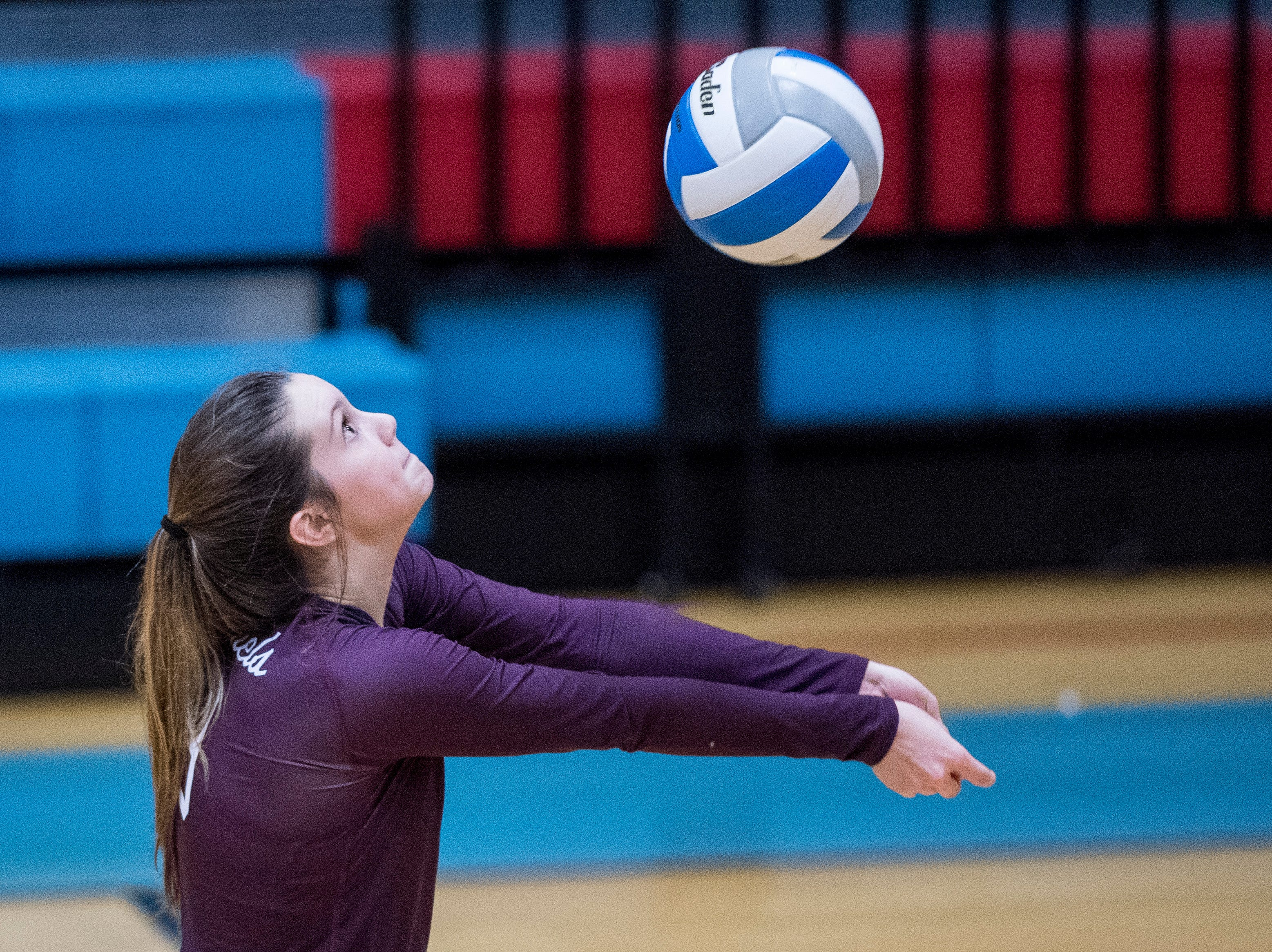 Henderson's Athena Sumner (13) sets the ball for a teammate during the Second Region Tournament game against the Hopkinsville Lady Tigers in Morganfield Tuesday, Oct. 16, 2018. Henderson County beat Hopkinsville, 3-1.