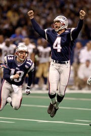 New England Patriots' kicker Adam Vinatieri celebrates his 48-yard game-winning field goal in the final seconds of Super Bowl XXXVI against the St. Louis Rams Sunday Feb. 3 2002 in New Orleans. At left is teammate Ken Walters. (AP Photo/Amy Sancetta)
