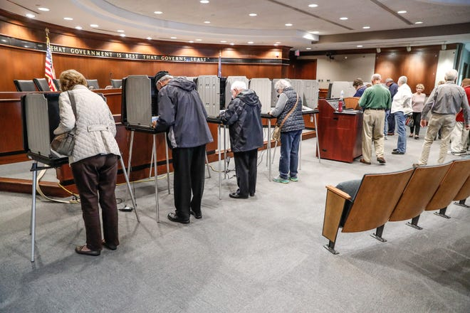 Voters line up for early voting at Hamilton County Government and Judicial Center Building in Noblesville Ind. on Wed. October 17, 2018.