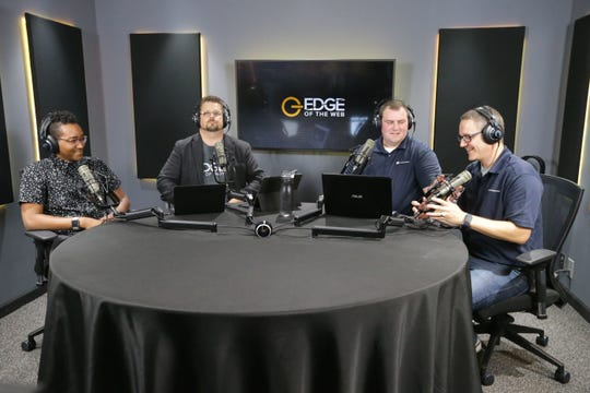 "Podcast guest Muhammad Yasin, left, from PERQ joins the ""Edge of the Web"" podcast hots Erin Sparks, center left, Tom Brodbeck, center right, and Nate Torvik, right, in the studio at Site Strategics, a digital marketing company, on Thursday, August 3, 2017. The podcast recently won a recently won a national ""Best Podcast/Audio Series"" award."