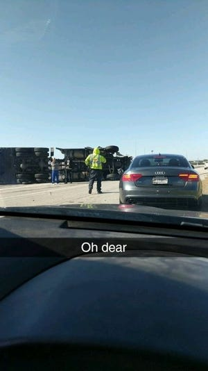 An overturned semi Wednesday closed all westbound lanes of I-465 in northeastern Indianapolis near Castleton.