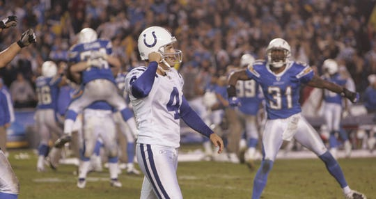 Adam Vinatieri, of the Colts, walks off the field after his miss near the end of the fourth quarter.   Chargers won 23-21.  Qualcomm Stadium, San Diego, CA, Sunday, November 11, 2007.  Indianapolis Colts at San Diego Chargers.  (Robert Scheer/The Indianapolis Star)