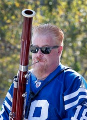 Mark Ortwein performs with Rock E Bassoon, a rock band that is comprised of six bassoonists and a drummer. Here they are performing before the start of an Indianapolis Colts game at Lucas Oil Stadium on Sunday, Sept. 30, 2018.
