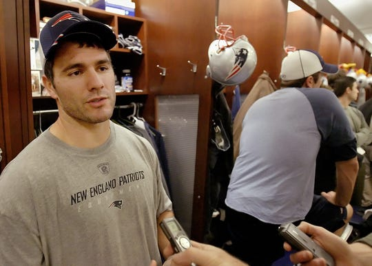 New England Patriots place kicker Adam Vinatieri talks to a reporter about how he thinks the AFC East division stacks up this year, compared to the past few years, during a media availability in the locker room at the team's facility in Foxborough, Mass., Wednesday morning Dec. 7, 2005. (AP Photo/Stephan Savoia)