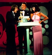 """Sonny Bono and Cher are shown with Ronald Reagan on the """"Sonny and Cher Comedy Hour"""" on CBS."""