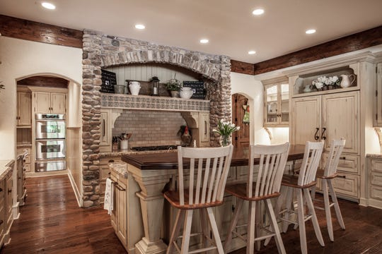 The kitchen is designed for entertaining with the oven in a separate hallway.