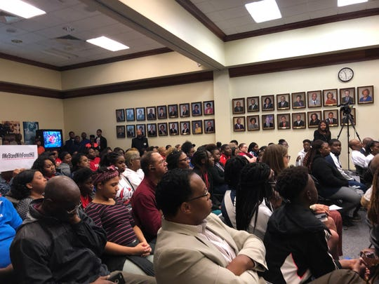 Forest Hill band members and supporters are asking that district officials reinstate a band director responsible for a controversial halftime show.
