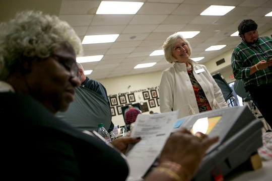 Voting officials thank residents for coming out to cast their votes at Madison County Agricultural Complex in Jackson, Tenn., on Wednesday, Oct. 17, 2018.