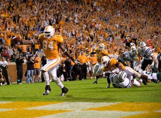 Tennessee defensive end Chris Walker intercepts a pass and runs it in for a touchdown against Ohio on Sept. 26, 2009, at Neyland Stadium.